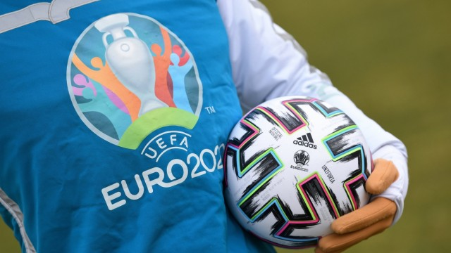 UEFA Euro 2020 mascot Skillzy poses for a photo with the official match ball at Olympiapark in Munich
