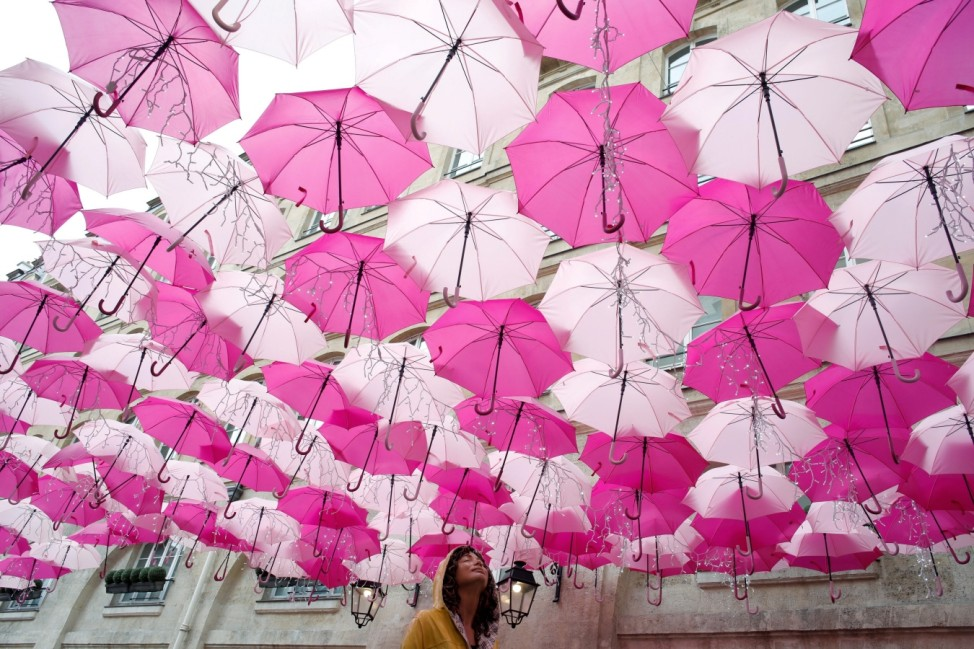 An installation entitled 'Umbrella Sky Project' created by Portuguese artist Patricia Cunha and composed with pink umbrellas is pictured in Paris