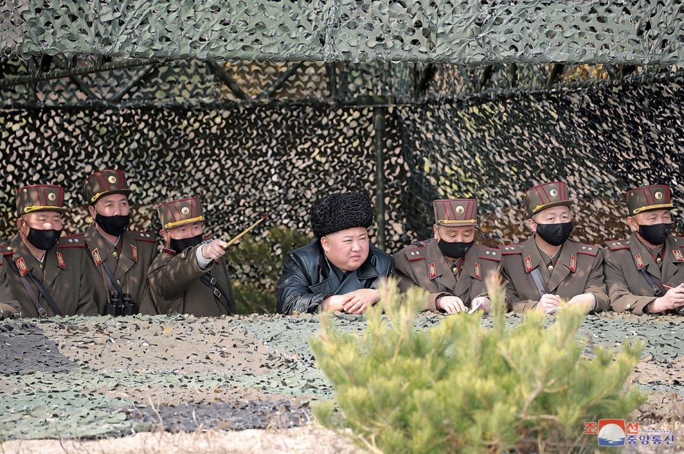 North Korea leader Kim Jong Un observes an artillery fire competition between the artillery units under the Korean People's Army Corps 7 and Corps 9 at a training ground in North Korea