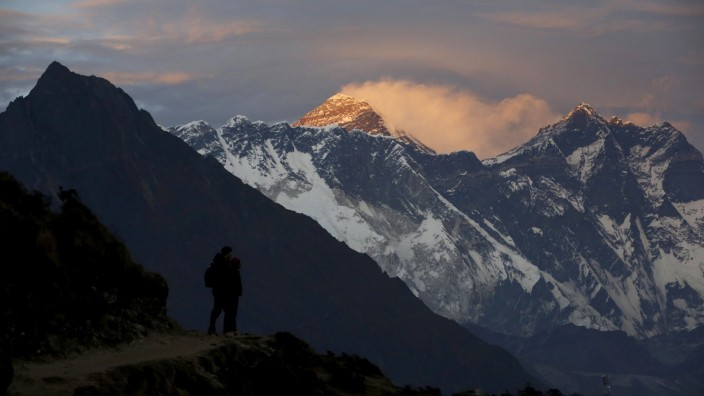FILE PHOTO: Light illuminates Mount Everest during sunset in Solukhumbu district also known as the Everest region