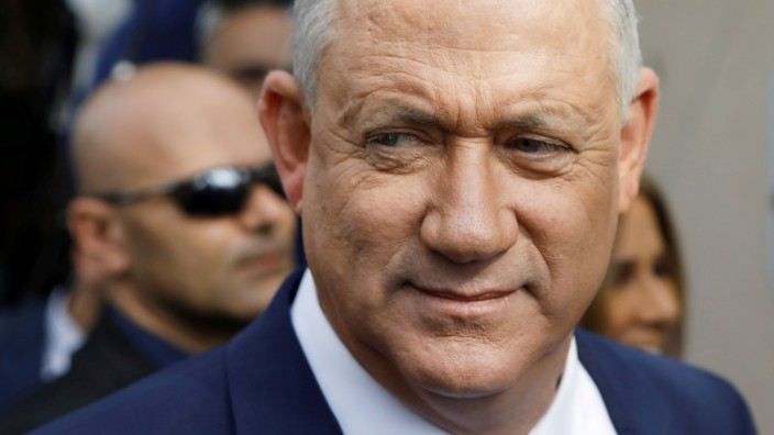 FILE PHOTO: Leader of Blue and White party, Benny Gantz looks on after voting at a polling station in Israel's national election in Rosh Ha'ayin, Israel