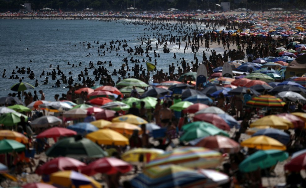People gather in Ipanema beach one day after authorities announced measures on coronavirus outbreak, in Rio de Janeiro