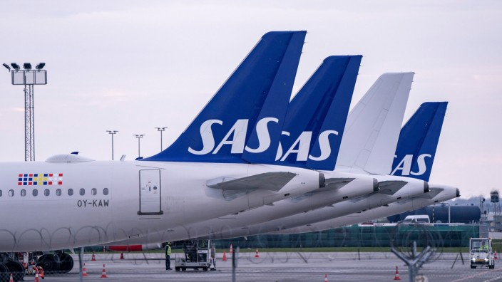 SAS Airbus A320 planes are parked at Copenhagen airport in Kastrup