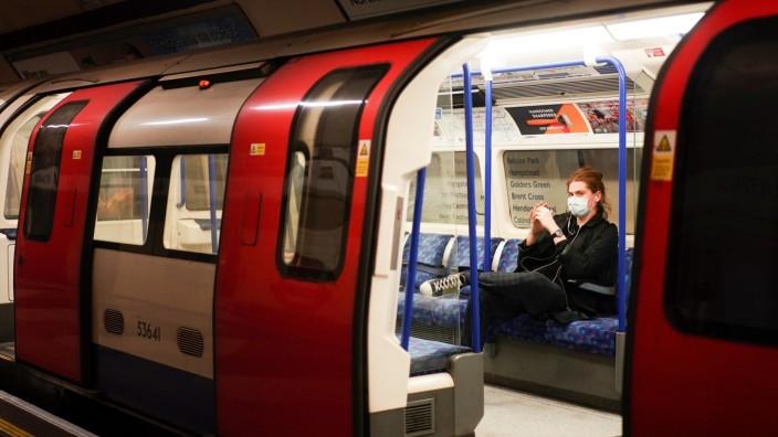 A person is seen wearing a protective face mask on the London Underground, as the number of coronavirus (COVID-19) cases grow around the world, in London