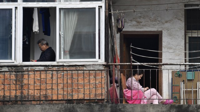 The Wider Image: Life under lockdown: Wuhan's windows, balconies and rooftops