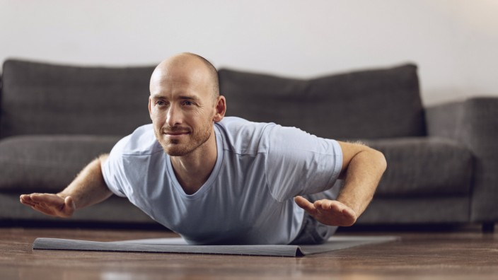 Man doing yoga at home model released Symbolfoto property released PUBLICATIONxINxGERxSUIxAUTxHUNxONLY MCF00305; Mann