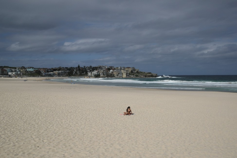 A single sunbather remains following the closure of Bondi Beach to prevent the spread of the coronavirus disease (COVID-19) in Sydney