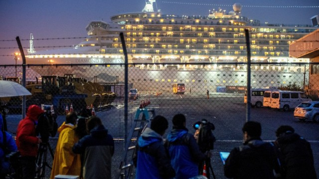 A bus arrives near the cruise ship Diamond Princess, where dozens of passengers were tested positive for coronavirus, at Daikoku Pier Cruise Terminal in Yokohama