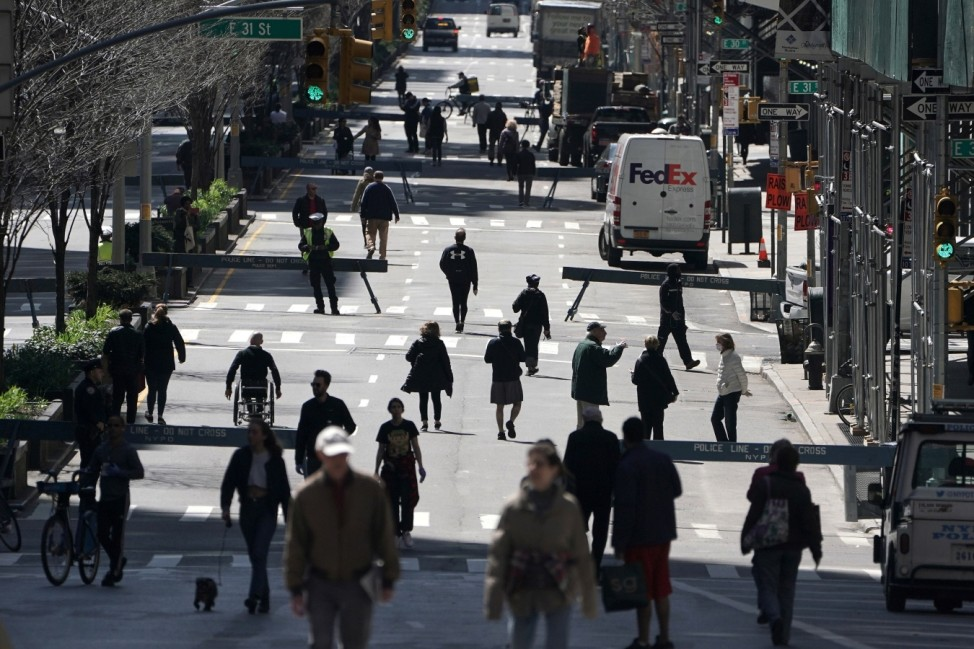 People walk on Park Avenue that was closed to vehicular traffic in New York City