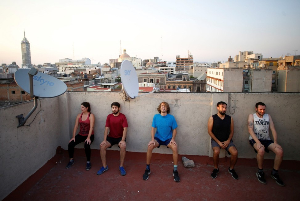 People exercise on a roof as the spread of the coronavirus disease (COVID-19) continues in Mexico City