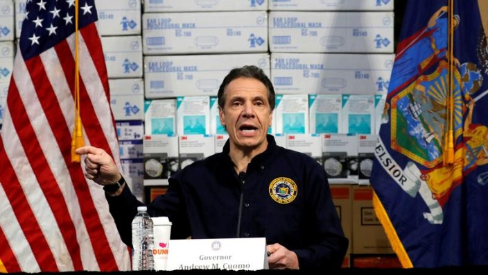 FILE PHOTO: New York Governor Andrew Cuomo speaks in front of stacks of medical protective supplies at a news conference at the Jacob K. Javits Convention Center which will be partially converted into a temporary hospital during the outbreak of the corona