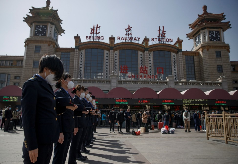 Railway staff pay tribute as China holds national mourning for those who died of the coronavirus disease (COVID-19) at the Beijing Railway Station