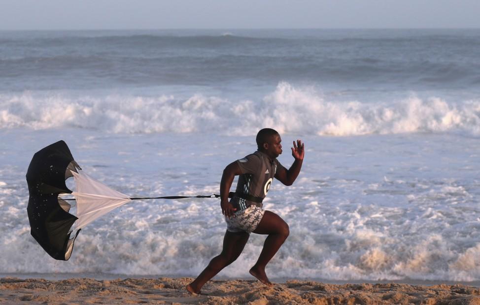 A man exercises on Recreio dos Bandeirantes beach, amid the coronavirus disease (COVID-19) outbreak, in Rio de Janeiro