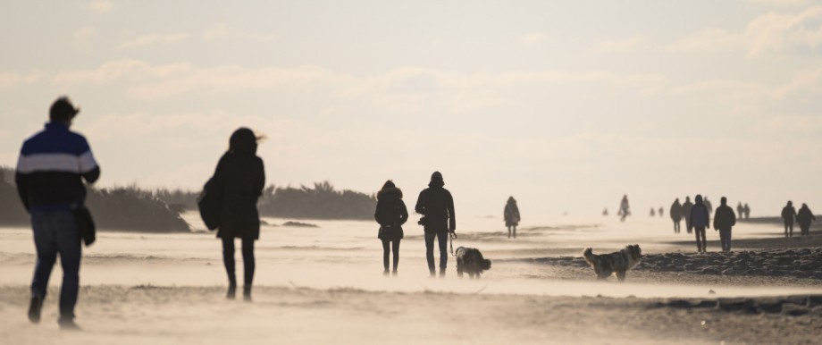 Walkers on the North Sea beach of Cuxhaven-Duhnen