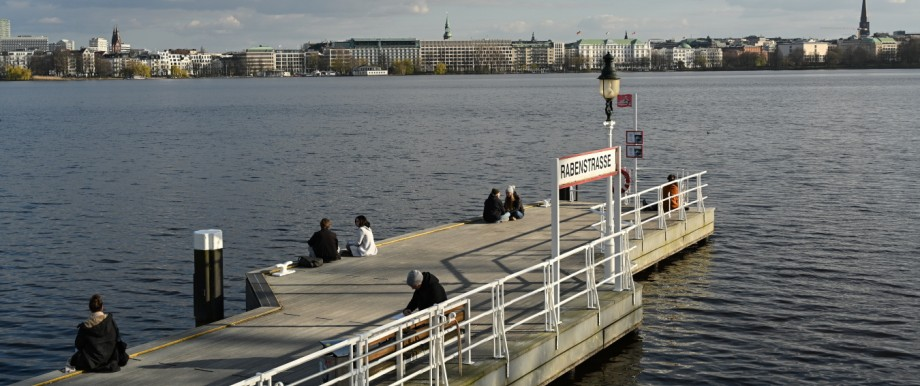 Few people sit in Hamburg on the Outer Alster.