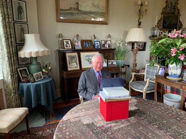 Britain's Prince Charles sends a video message, to the guests at the opening of the NHS Nightingale Hospital in London, from his home in Birkhall