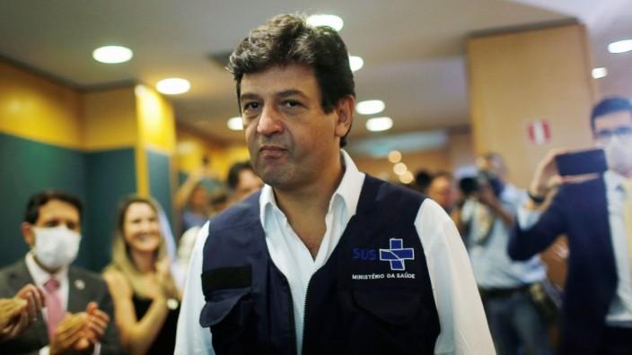Brazil's Minister of Health Luiz Henrique Mandetta arrives to a news conference, amid the coronavirus disease (COVID-19) outbreak in Brasilia