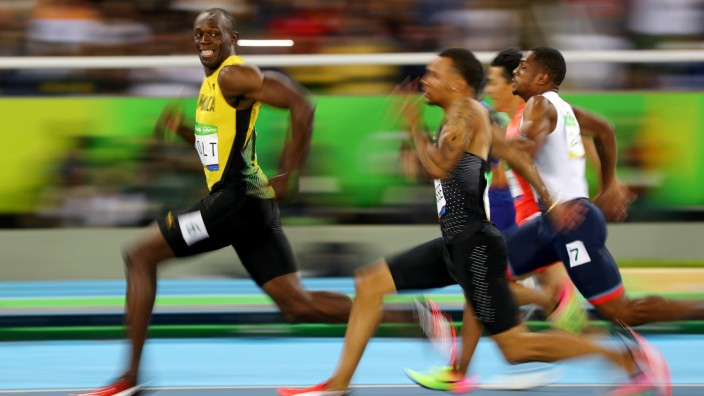 FILE PHOTO: Usain Bolt (JAM) of Jamaica looks at Andre De Grasse (CAN) of Canada as they compete in the 2016 Rio Olympics, Men's 100m Semifinals at the Olympic Stadium in Rio de Janeiro
