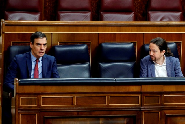 Spanish PM Sanchez paand second deputy PM Iglesias talk keeping social distancing during a session on coronavirus disease (COVID-19) at Parliament in Madrid