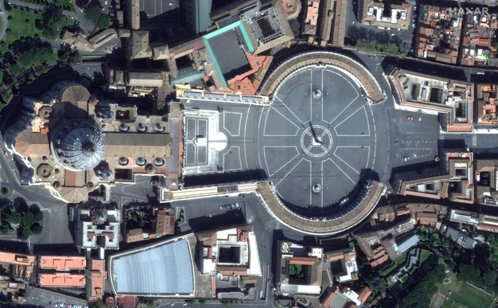 An empty view of St. PeterâÄÖs Square and the Basilica is seen on Palm Sunday in Vatican City, during the coronavirus disease (COVID-19) outbreak April 5, 2020 in this handout satellite image.