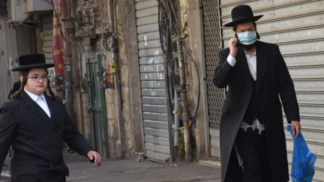 An Ultra-Orthodox Jew wears a mask, as protection from the coronavirus, while shopping for the Jewish holiday Passover,