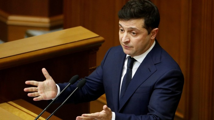 FILE PHOTO: Ukrainian President Volodymyr Zelenskiy delivers a speech during a parliamentary session in Kiev