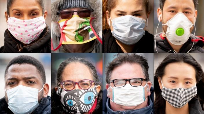 Coronavirus: Menschen mit Mundschutz in Berlin