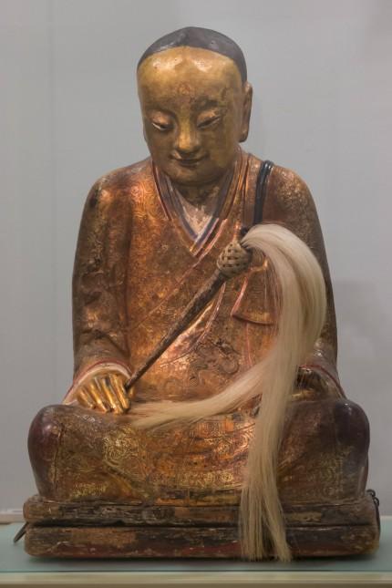 150305 BUDAPEST March 5 2015 A Chinese Buddha statue with the mummified body of a Buddhist