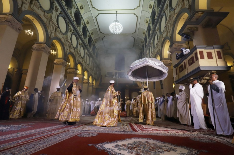 Ethiopian Orthodox deacons sing during the Easter eve sermon at the Holy Trinity Cathedral amid the coronavirus disease (COVID-19) outbreak Addis Ababa
