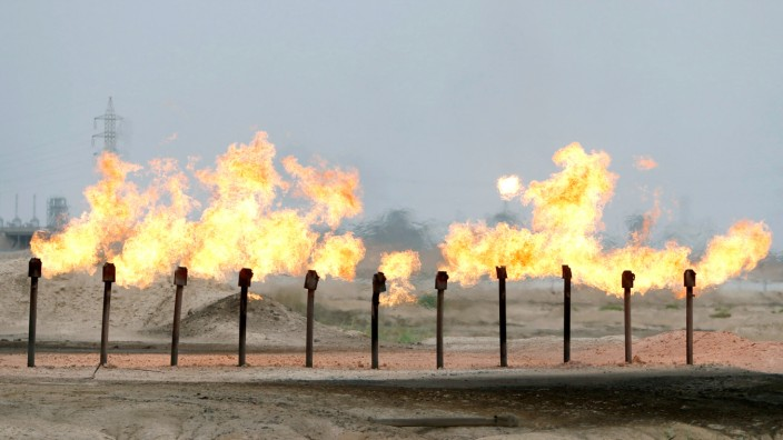 Flames are seen at a station in al-Zubair oil field, near Basra