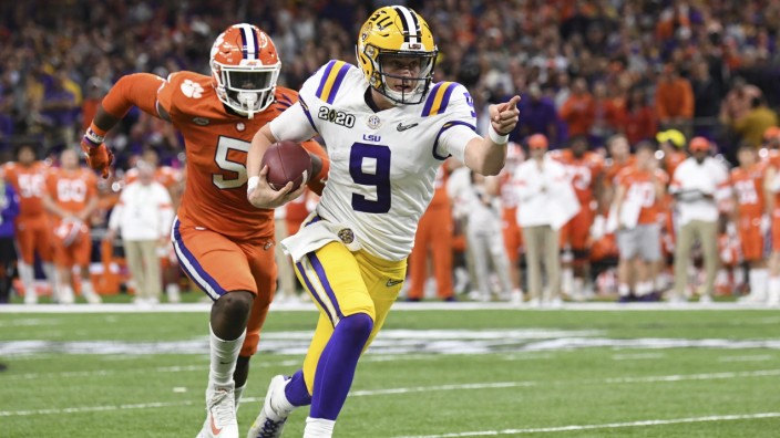 LSU s quarterback Joe Burrow runs for 29 yards to set up a touchdown in second quarter of the college national champions
