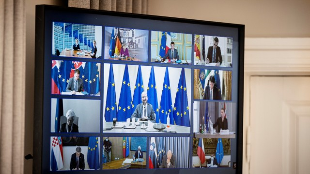 A screen displays E.U. heads of state as Denmark's Prime Minister Mette Frederiksen takes part in a video call meeting in Marienborg, her official residence, in Copenhagen