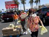 Las Vegas Residents In Need Pick Up Goods At Local Food Bank Drive-Thru Distribution