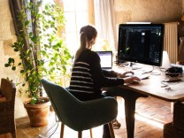 FRANCE - ANGERS SOCIAL DISTANCING IN ANGERS A woman is installed in her living room and works remotely during the confi