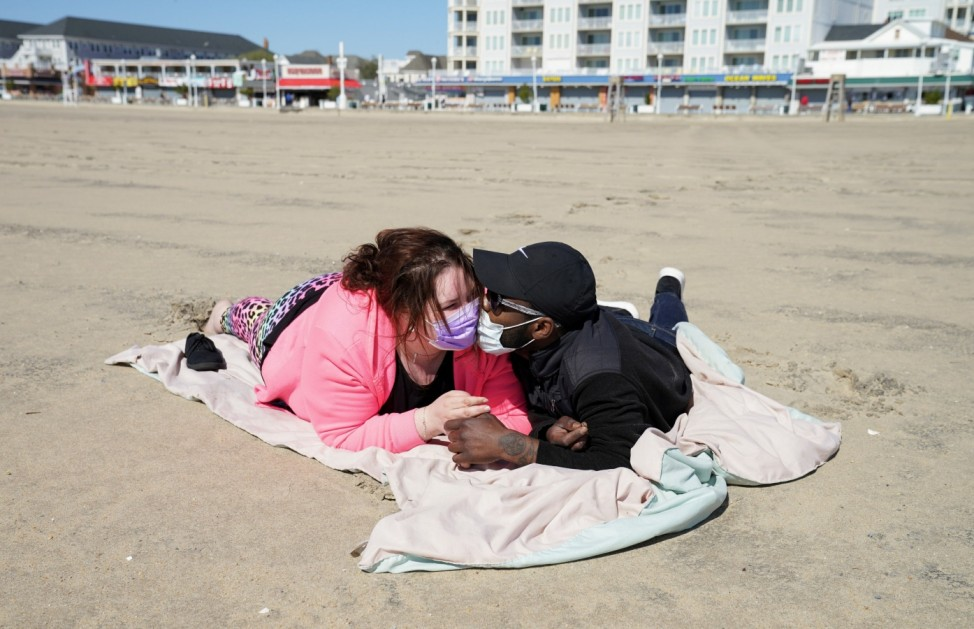 Couple on the beach as coronavirus disease (COVID-19) restrictions are eased at Ocean City in Maryland