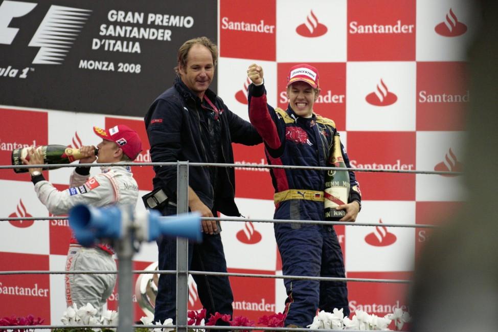 2008 Italian GP AUTODROMO NAZIONALE MONZA, ITALY - SEPTEMBER 14: Sebastian Vettel celebrates victory on the podium with; Vettel Monza 2008