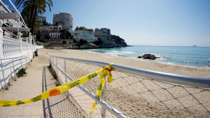 FILE PHOTO: A police restriction tape is seen at the beach of Cala Major during the coronavirus disease (COVID-19) outbreak in Mallorca