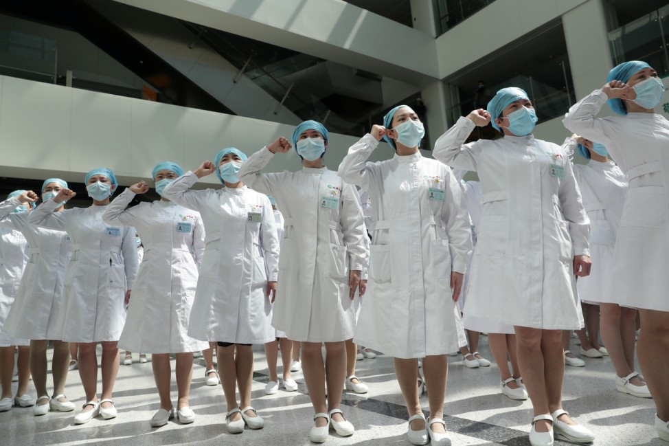 Nurses take part in an event held to mark the International Nurses Day in Wuhan