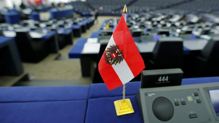 An Austrian flag is seen on the desk of a MEP during a debate at the European Parliament in Strasbourg