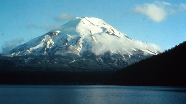 Mount St. Helens and Spirit Lake in August 1973 when its summit was 9 677 feet above sea level. Courtesy Everett Collect