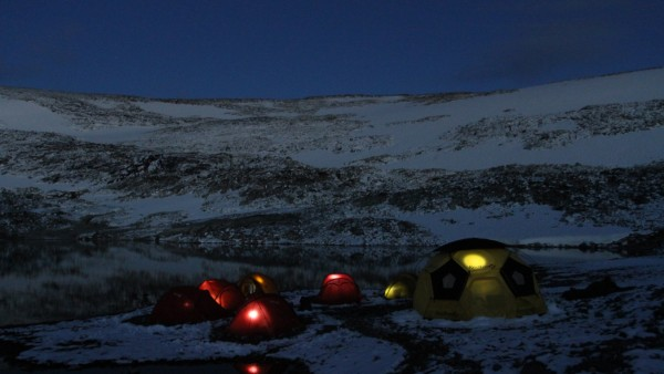 Basecamp at Lendbreen during a silent and clear night. Photo: secretsoftheice.com.