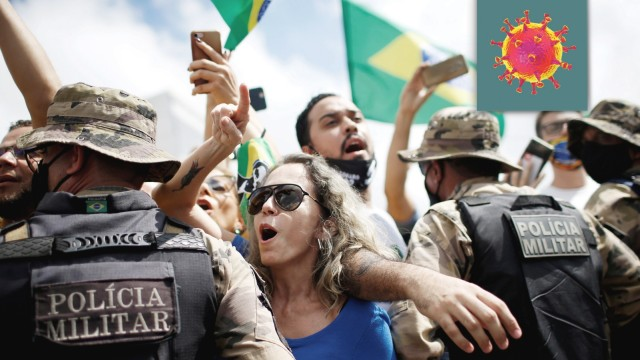Demonstrators take part in a protest in favor of Brazillian President Jair Bolsonaro in front of the Planalto Palace, amid the coronavirus disease (COVID-19) outbreak, in Brasilia