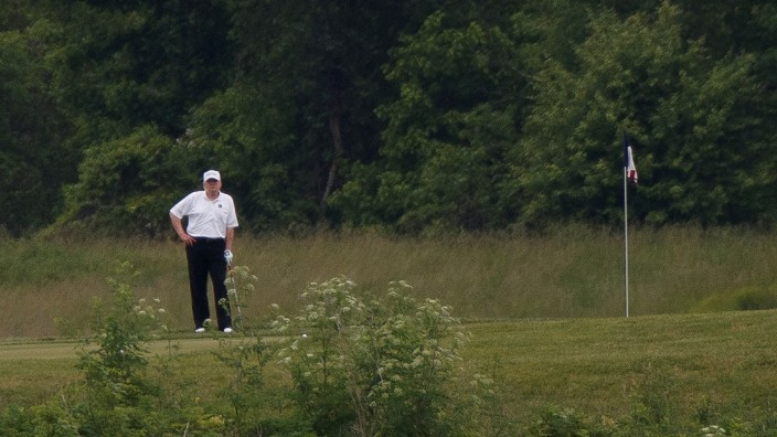 U.S. President Donald Trump participates in a round of golf at the Trump National Golf Course in Sterling, Virginia