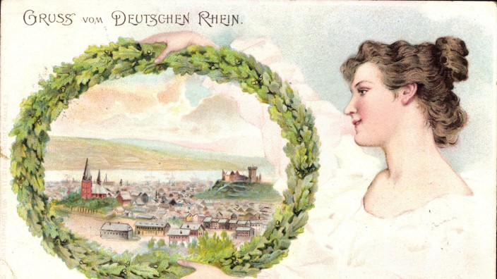 Bingen am Rhein Frau hält Eichenblattkranz mit Sicht auf den Ort AUFNAHMEDATUM GESCHÄTZT