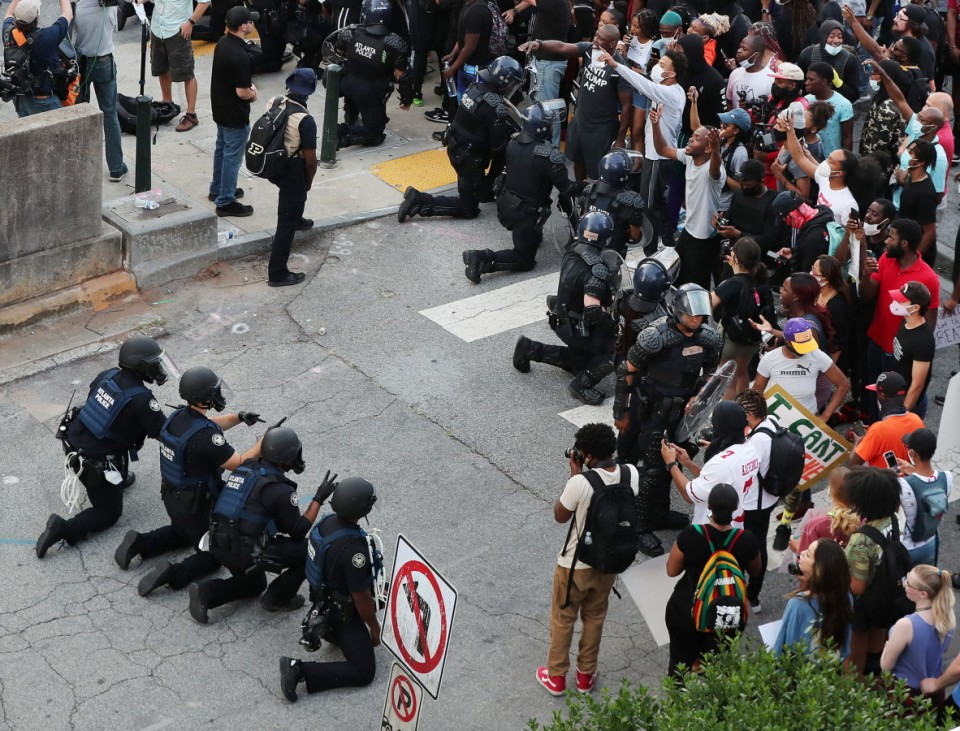June 1, 2020, Atlanta, GA, USA: In a show of peace and solidarity, law enforcement officials with riot shields take a k