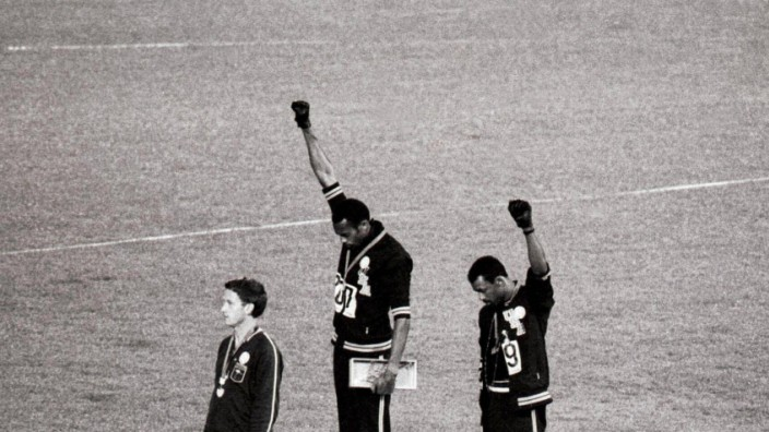 1968 Olympic Games Mexico City America s gold and bronze medallists Tommie Smith centre and John