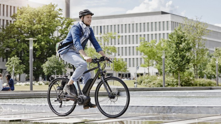 Student on his e-bike at Goethe University in Frankfurt, Germany model released Symbolfoto property released PUBLICATIO