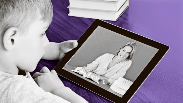 Boy Videoconferencing On Digital Tablet model released Symbolfoto PUBLICATIONxINxGERxSUIxAUTxONLY Co