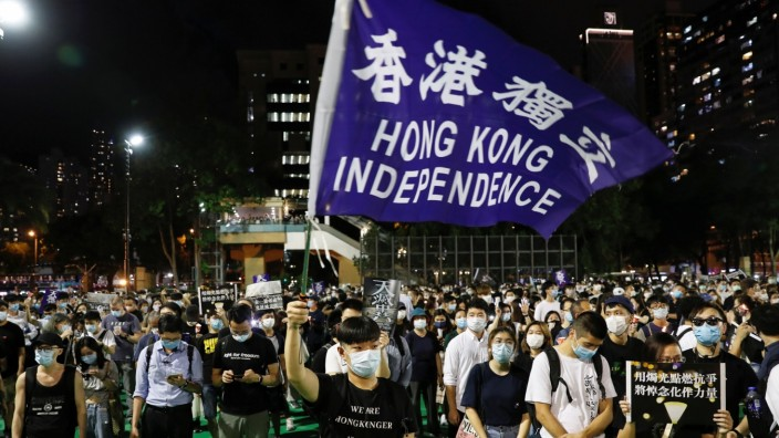 Protesters take part in a candlelight vigil to mark the 31st anniversary of the crackdown of pro-democracy protests at Beijing's Tiananmen Square in 1989, in Hong Kong