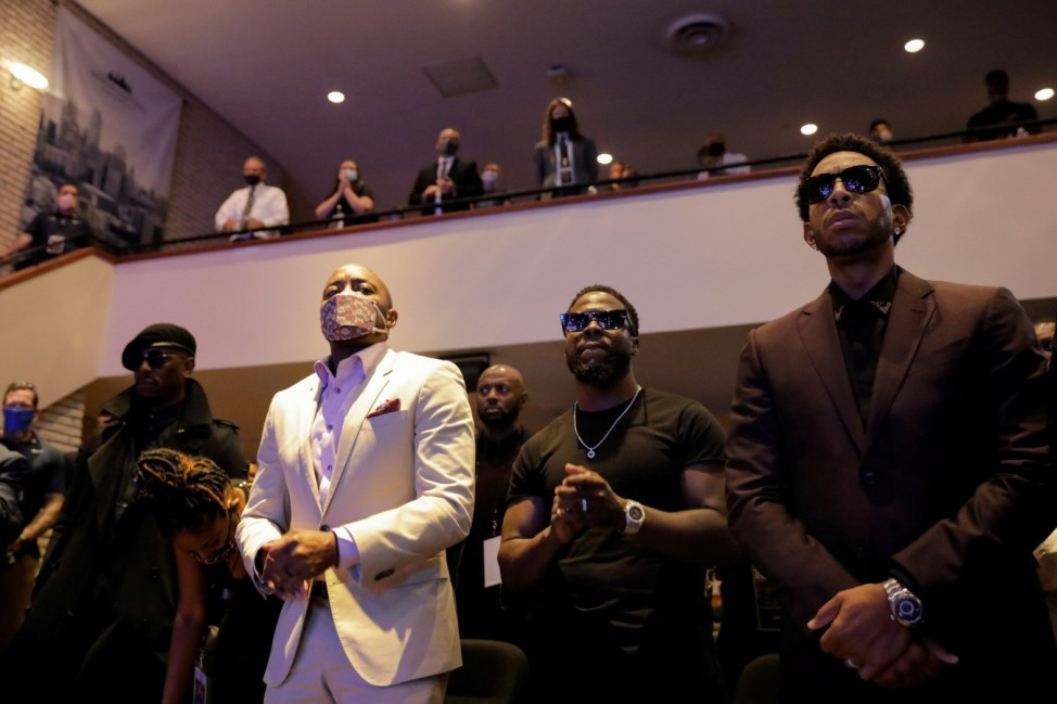 Actor Kevin Hart and musician Ludacris attend a memorial service for George Floyd following his death in Minneapolis police custody, in Minneapolis